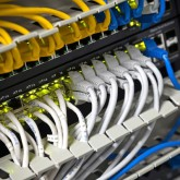 Large network hub and connected Internet cables. Selective focus